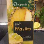 Zumo de piña y uva